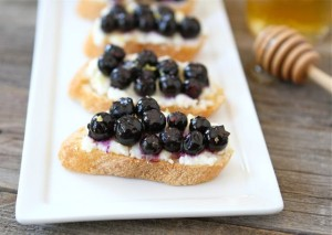 12 Festive Easter Recipes: Roasted Blueberry Ricotta Crostini | OnceAMomAlwaysAMom.com